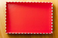 Red lid of gift box. Red lid of gift box on wood surface. Christmas bo cover inside view Stock Photo