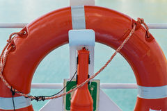 Red life belt. On the railing of the ferry royalty free stock image
