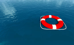 Red life belt on sea Royalty Free Stock Photo