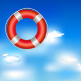 Red Life Buoy. In Bue Sky With Clouds Royalty Free Stock Photography