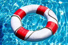 Red life buoy. Life buoy ring floating in water Stock Image