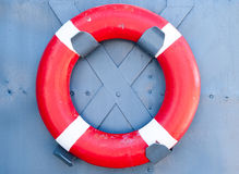 Red life buoy. A flotation device in case of drowning Stock Images