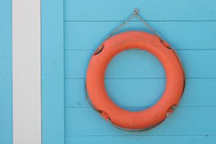 Red life buoy hanging. At a lake Royalty Free Stock Photography
