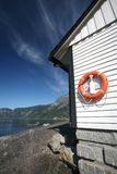 Red life buoy, life ring in Eidfjord Royalty Free Stock Photos