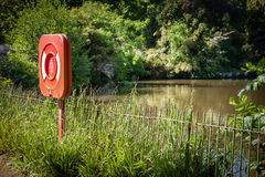 Red Life Buoy Ring by Lake Royalty Free Stock Photo