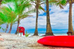 Red life buoy with rope and a flag Royalty Free Stock Images