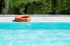 A life buoy for safety on the edge of pool royalty free stock images