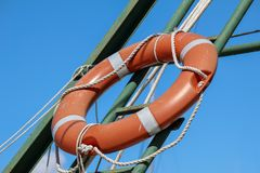 Red life buoy on the sea beach. The red circle on the Sea Beach royalty free stock photography