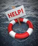 Red life buoy with a sign HELP. In the water Stock Images