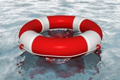 Red life buoy in the water Royalty Free Stock Photos