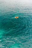 Red life buoy in the water Stock Images