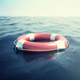 Red life buoy on the waves as a symbol of help and hope. 3d illustration Stock Photos