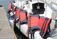Red life jacket hang on the the boat Royalty Free Stock Photos