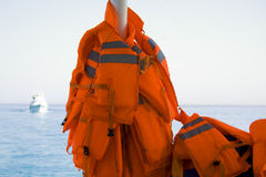 Red life jackets. The red life jackets on boat Royalty Free Stock Photo