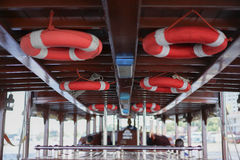 Red life ring. On the ceiling boat Stock Photo