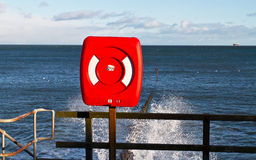 Red Lifebelt by the seaside. Lifebelt on Aberdeen seaside, Scotland Royalty Free Stock Photography