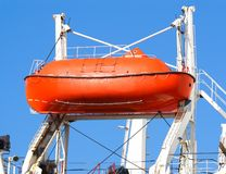 Red lifeboat on crane lift Royalty Free Stock Image