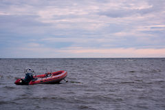 Red lifeboat in water royalty free stock images