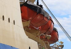 Red lifeboats closeup. Rescue equipment of the port side of the icebreaker Krasin. Saint Petersburg, Russia Stock Photos