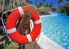 Red lifebuoy. At the resort swimming pool Royalty Free Stock Photography