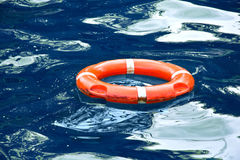 Red lifebuoy in blue water. Safe concept Stock Photography