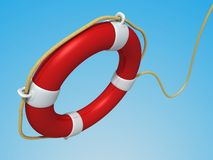 Red Lifebuoy flying against the blue sky Stock Image