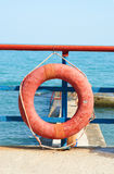 Red Lifebuoy in front. Of the blue sea Stock Photo