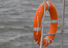 Red lifebuoy. Hanging on railings of rescue boat Stock Photo