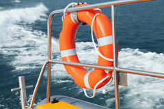 Red lifebuoy hanging on stern railings, close up Stock Image