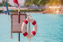 red lifebuoy near public swimming pool Royalty Free Stock Images