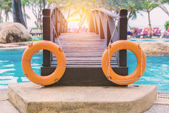 Red lifebuoy near a public swimming pool.  Stock Images