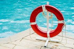 Red lifebuoy near swimming pool. At tropical hotel Royalty Free Stock Images