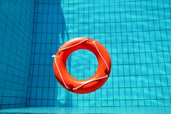 Red lifebuoy pool ring float, ring floating in refreshing. Stock Photos