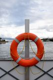 Red lifebuoy on quay Stock Image