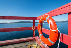 Red lifebuoy on a red ocean pier Royalty Free Stock Image