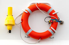 Red lifebuoy with rope. On white ship wall Royalty Free Stock Photos