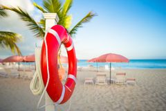 Red lifebuoy on the white sand beach Stock Photography
