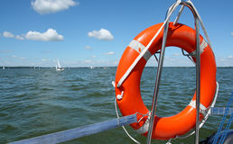 Red lifebuoy on yacht Stock Images