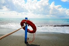 Red lifesaver on the beach - rescue concept.  Royalty Free Stock Photography