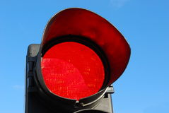 Red light. Red traffic light against blue sky Stock Photo