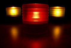 Red Light. Composition of one red and two yellow candles royalty free stock photo