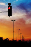 Red light. Red traffic light and dramatic sky Stock Image