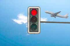 Red light in the background a plane. Royalty Free Stock Image