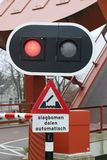 Red light at bridge for cyclist with tekst slagbomen dalen auto. Several colors of hyacints in  a field in the area of Lisse close to the Keukenhof, famous about Stock Photo