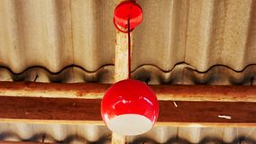Red light bulb on the ceiling stock image