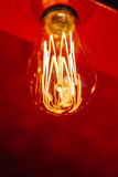 Red light bulb glowing Stock Photo