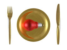 Red light bulb, golden plate, fork and knife. Top view Stock Images