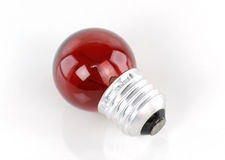 Red light bulb isolated on white background Stock Photography
