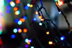 Red light Christmas garland Stock Photography