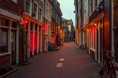 Red light district in Amsterdam, the Netherlands, night view. Windows and doors where prostitutes work royalty free stock photos
